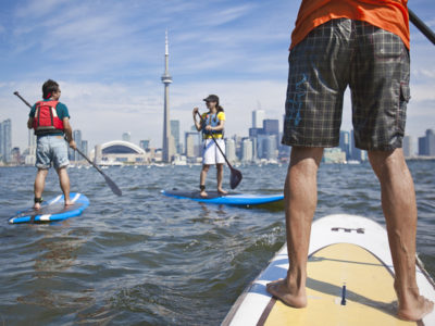 Students out on a SUP board at Harbourfront Canoe & Kayak Center Photograph by Goh Iromoto