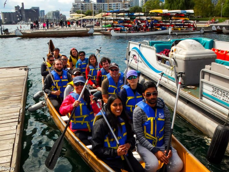 People out in a voyageur canoe with Harbourfront Canoe & Kayak Center